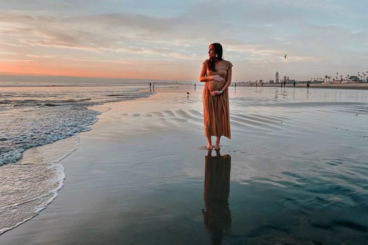pregnant lady enjoying the beach